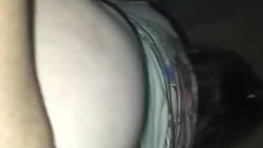 Fingering her ass while she rides dick