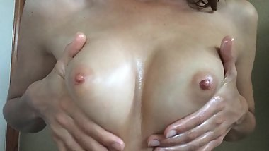 Oiled Up Natural Tits