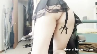 Gothic maid toys with her asshole
