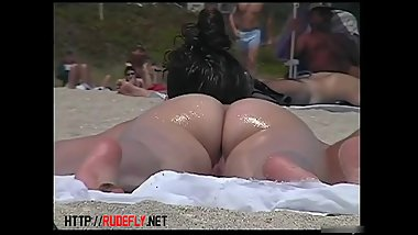 Porno of thin nude chicks on a nudist beach relaxing and talking