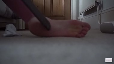 Blonde girl bacuuming her pink soles